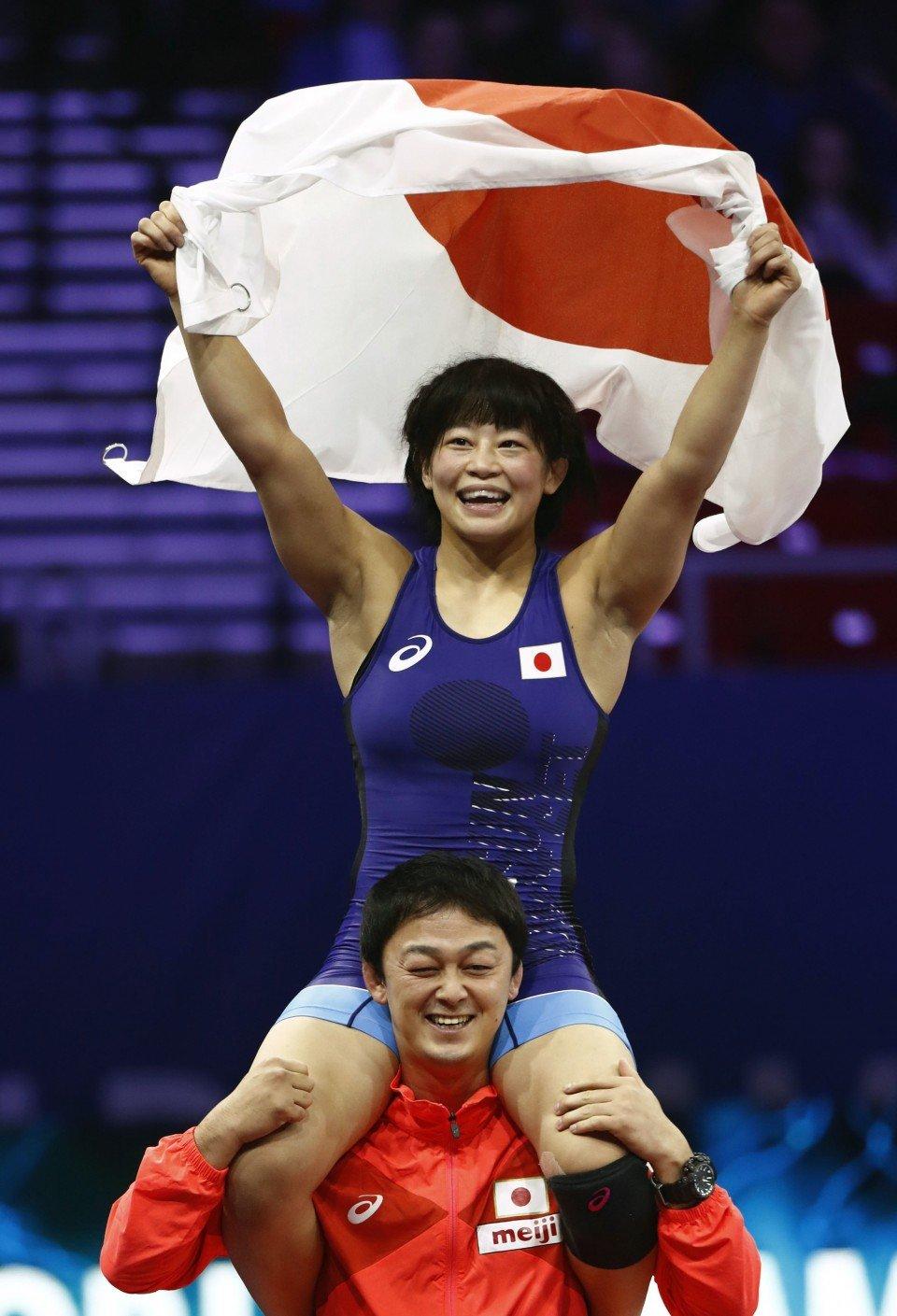 Coronavirus crashes Olympic party for wrestler-coach couple